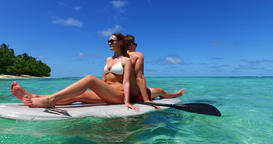 v11332 two 2 people romantic young people couple paddleboard surfboard with Live Action