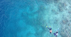 v11896 many people young boys girls snorkeling over coral reef with drone aerial Footage