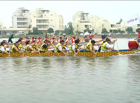 Dragon boat racing close up Live Action
