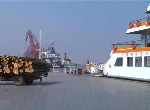 Truck exiting ferry in China Stock Video Footage