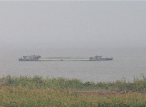 Barge sailing up the Yangzi River in China Stock Video Footage