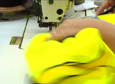 Factory worker's hands sewing jacket Footage