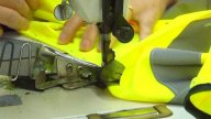 Factory Worker's Hands Sewing Jacket stock footage