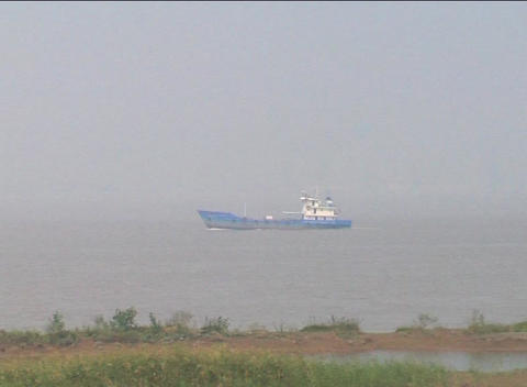Small ship sails up the Yangzi River in China Stock Video Footage