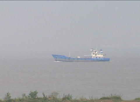 Small ship sails up the Yangzi River in China Footage