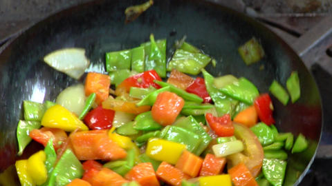 Sautee vegetables in frying pan Stock Video Footage