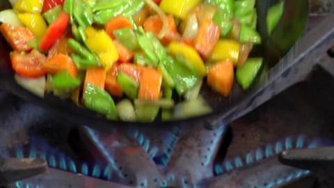 Sautee vegetables in frying pan Stock Video Footage