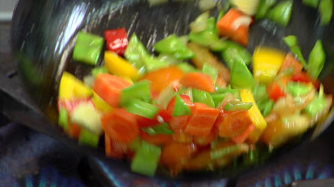 Sautee vegetables in frying pan Footage
