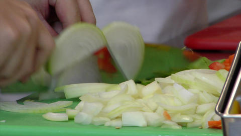 Slicing onions, meat and tomatoes in kitchen Footage