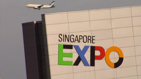 Plane flying by Singapore Expo Stock Video Footage