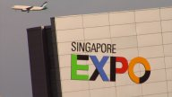 Plane Flying By Singapore Expo stock footage