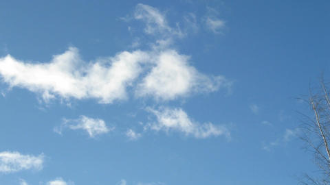 Time-lapse of fast moving midday clouds 1 Stock Video Footage