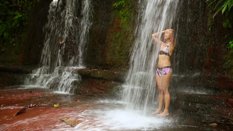 taking a shower in waterfall Stock Video Footage