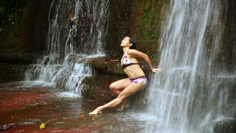 Sexy dancer on waterfall in rainforest Stock Video Footage