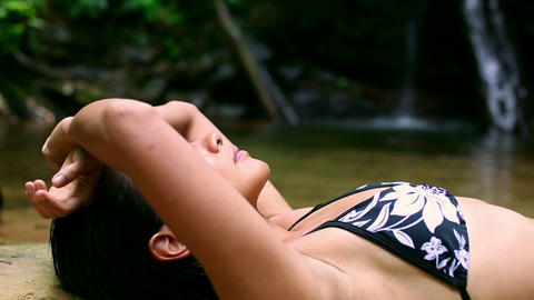 sexy girl lying down in river Stock Video Footage