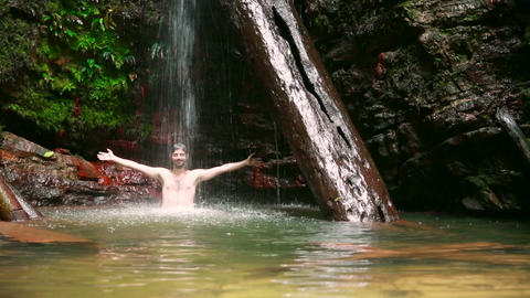 caucasian man enjoying in waterfall Stock Video Footage