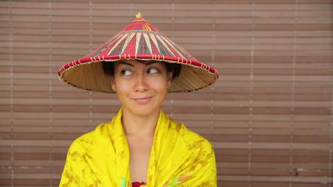 Attractive asian lady with hat Stock Video Footage