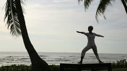 silhouette yoga meditation at beach Footage