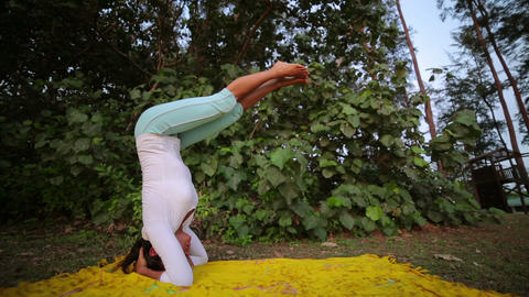 doing handstand yoga mediatation exercise Stock Video Footage