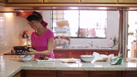 woman preparing meal in kitchen Stock Video Footage