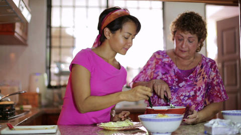 Mother daughter preparing meal together Stock Video Footage