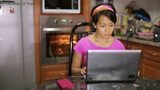 woman with laptop in kitchen Stock Video Footage