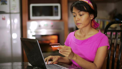 Woman shopping online in kitchen Stock Video Footage