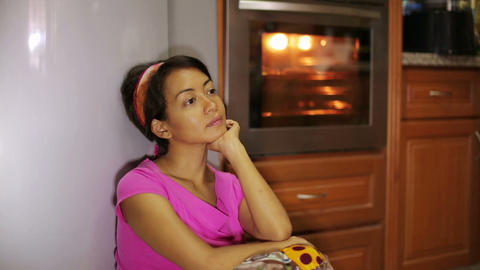 woman waiting for food in kitchen Stock Video Footage