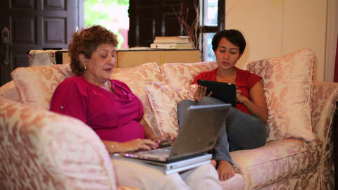 Mother daughter using tablet computer Stock Video Footage