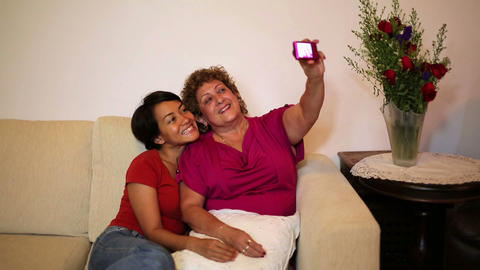 mother daughter taking own picture Stock Video Footage