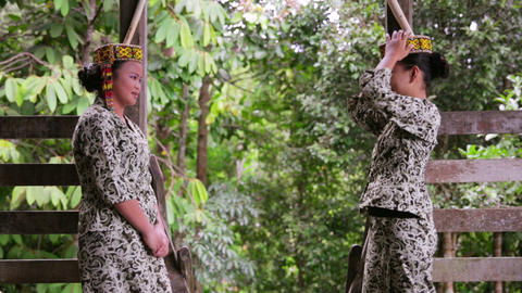 SARAWAK, MALAYSIA - JUNE 2012: Iban tribal girls in... Stock Video Footage