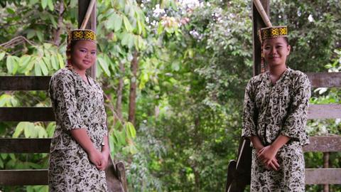 SARAWAK, MALAYSIA - JUNE 2012: Iban tribal girls in... Stock Video Footage