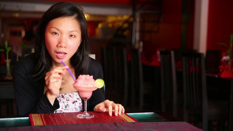 Asian young woman drink cocktail Stock Video Footage