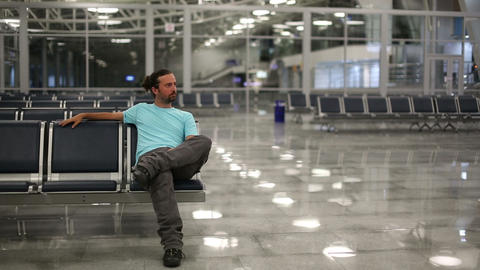 young man waiting his flight Stock Video Footage