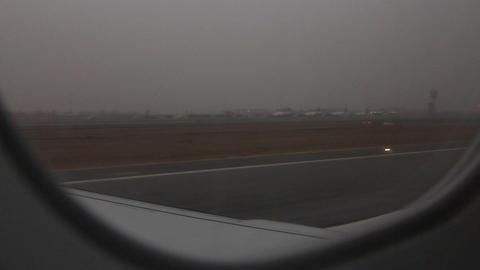 watching landing through plane window Stock Video Footage