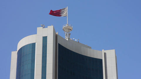 Bahrain flag on skyscraper Stock Video Footage