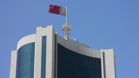 Bahrain flag on skyscraper Footage
