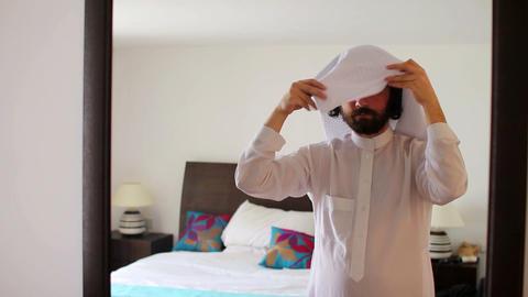 Arabic man dressing Stock Video Footage