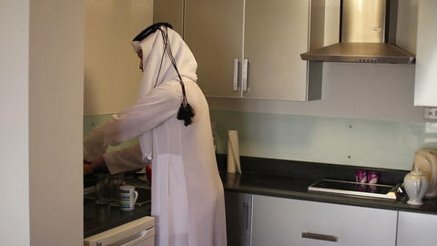 Arabian man washing dishes Stock Video Footage
