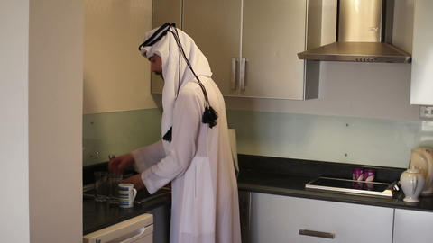 Arabian man washing dishes Footage