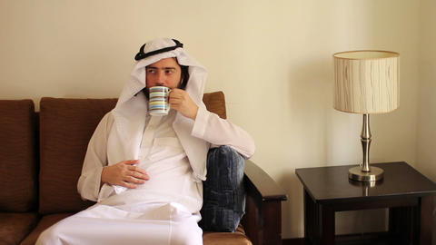Arabian man drink coffee Stock Video Footage