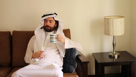 Arabian man drink coffee Footage