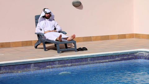 Saudi arabian at swimming pool Stock Video Footage