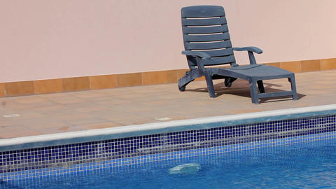 Sunbed at swimming pool Stock Video Footage