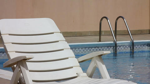 Sunbed at swimming pool Footage
