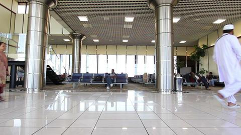 BAHRAIN AIRPORT - MARCH 2012: passengers waiting flight Footage