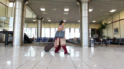 BAHRAIN AIRPORT - MARCH 2012: passengers waiting flight Stock Video Footage