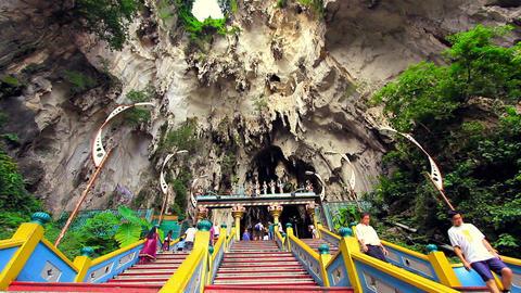 KUALA LUMPUR - MARCH 2012: people climbing batu caves steps Stock Video Footage