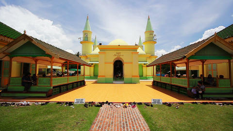 PENYENGAT ISLAND - MAY 2012: people at Sultan Riau Mosque Stock Video Footage