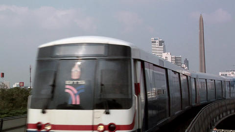 The Skytrain with the Victory Monument at the Background, Bangkok Live Action
